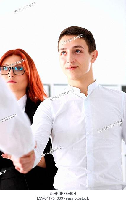 Smiling man in suit shake hands as hello in office portrait. Friend welcome mediation offer positive introduction greet or thanks gesture summit participate...