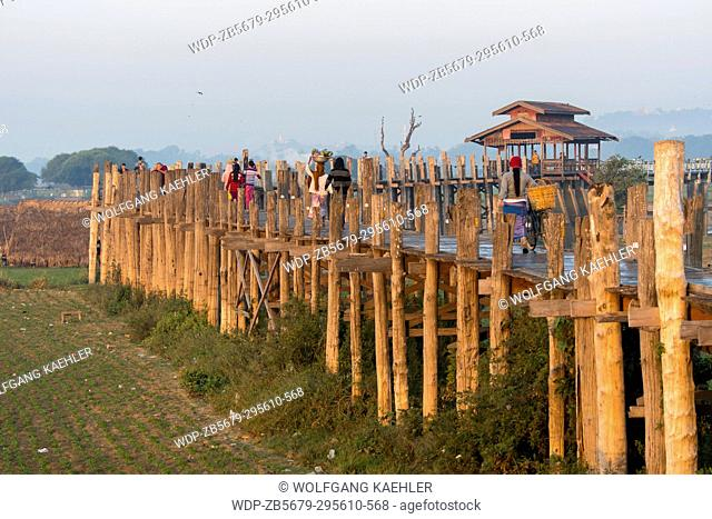 View of U Bein Bridge (built around 1850 and is believed to be the oldest and longest teakwood bridge in the world) spanning Taungthaman Lake near Amarapura