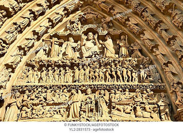 Tympanum of central west portal: Christ in Majesty presides over the Last Day of Judgement, supported by an array of saints
