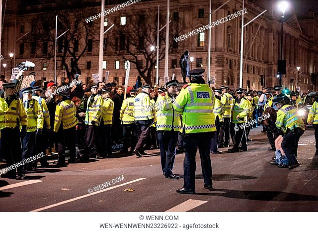 Protesters clash with police outside the Houses of Parliament during the Don't Bomb Syria Protest. A 10 hour debate will be taking place in the House of Commons...