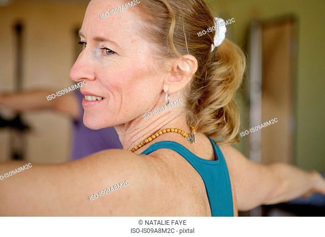 Close up of mature female exercising in class