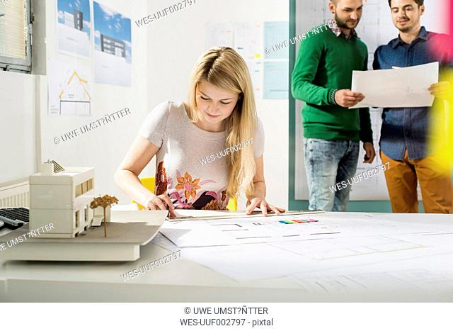 Three young architects in office