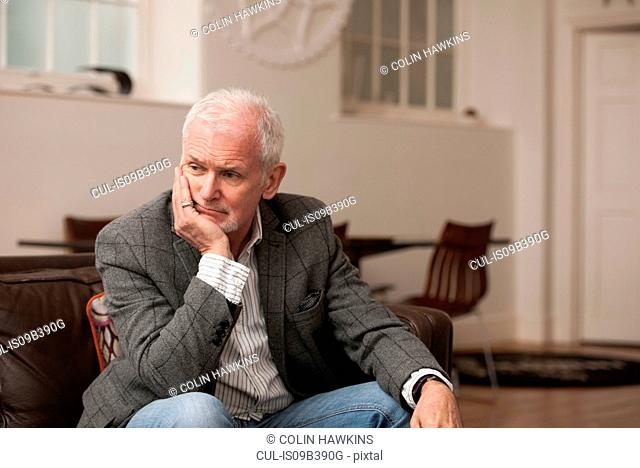 Man looking upset on couch