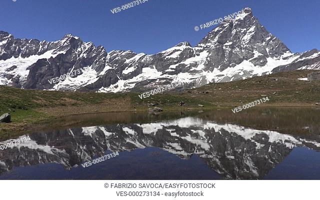 Mount Cervino or Matterhorn reflecting in an alpine lake, Aosta Valley, Italy