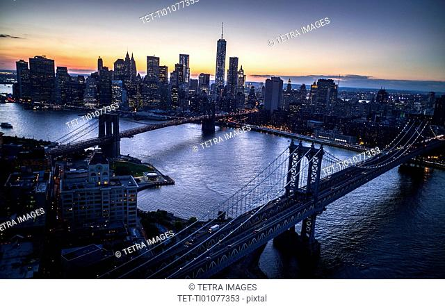 Aerial view of city with Freedom tower at sunset