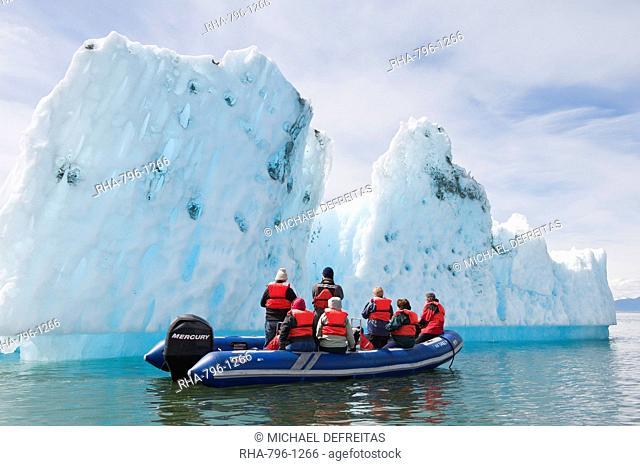 Exploring an iceberg in LeConte Bay, Southeast Alaska, United States of America, North America