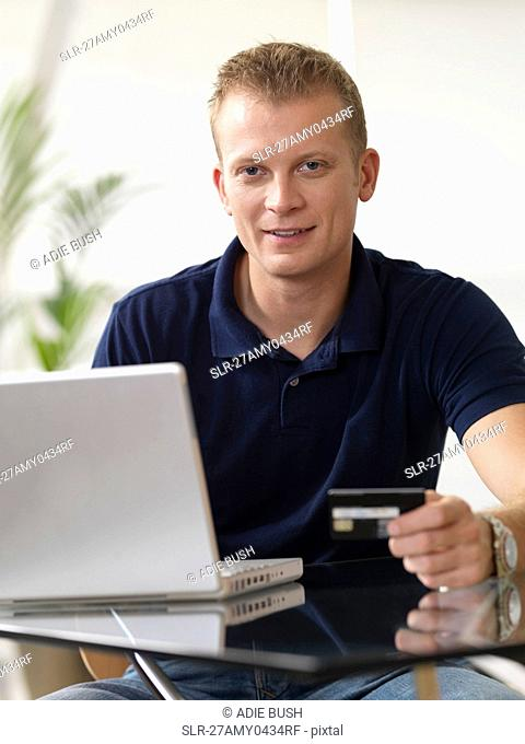 Man at home shopping online