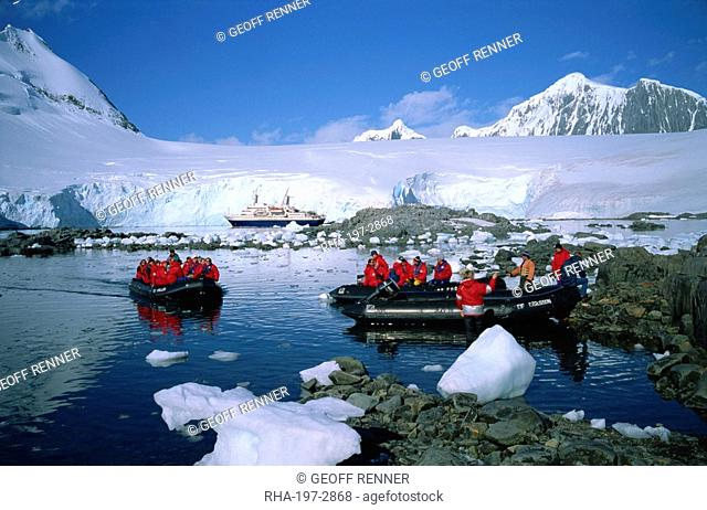 Cruise passengers on excursion by dinghy, Port Lockroy, once a Second World War British Station, now a post office, Antarctic Peninsula, Antarctica