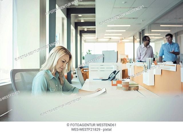 Businesswqoman working alone in office