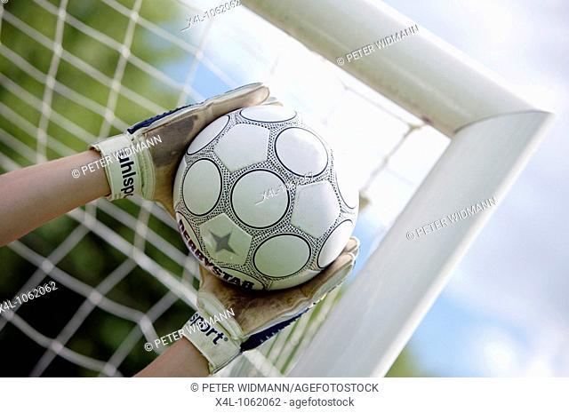 football player goalkeeper keeping goal