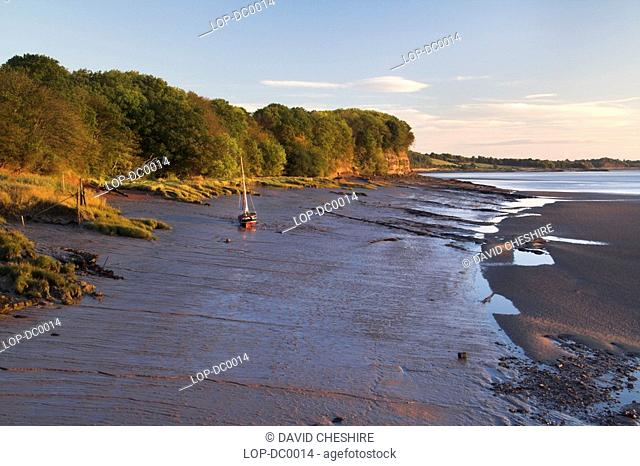 England, Gloucestershire, Lydney Docks, The River Severn at sunrise from Lydney Docks