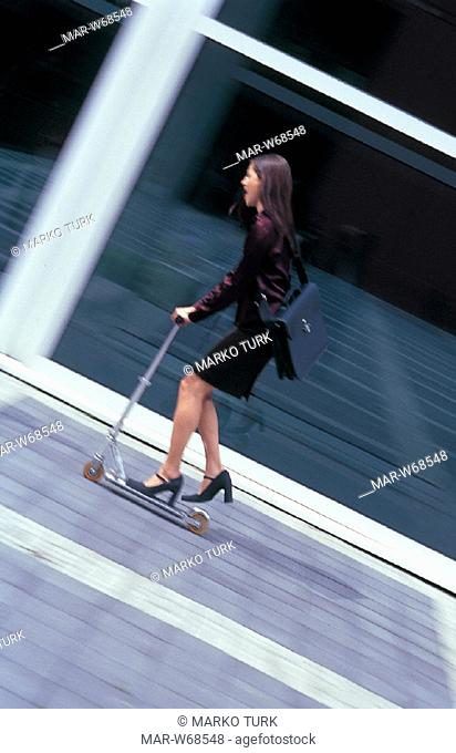 business woman riding scooter, outdoors