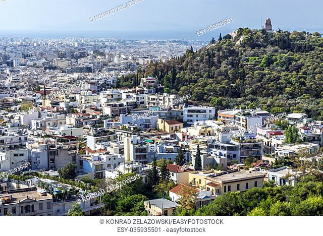 Aerial view from Acropolis of Athens city, Greece with Philopappos Monument on Musaios Hill