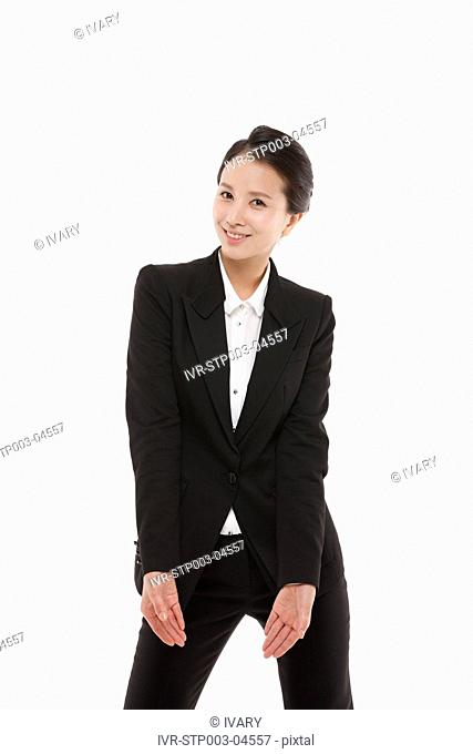 A young businesswoman posing in a studio