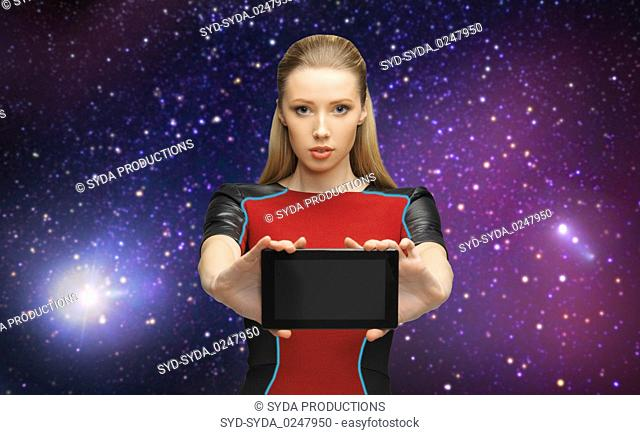 futuristic woman with tablet pc over space
