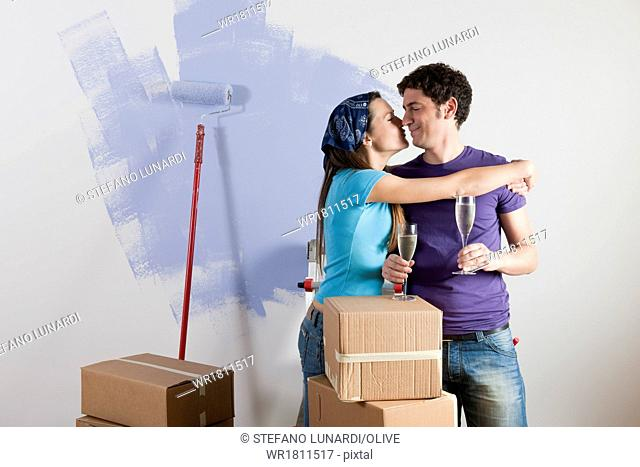 Young couple celebrating their new house on moving day
