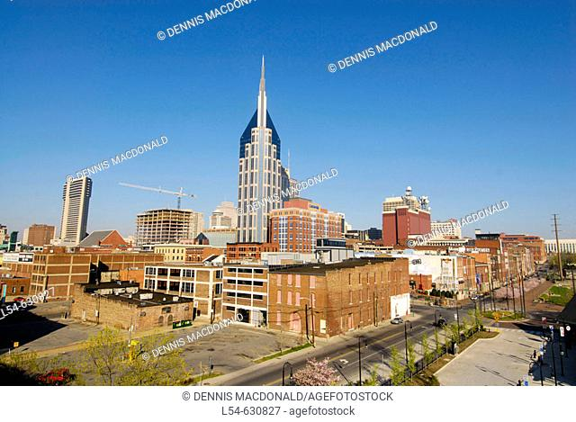 Cityscape Skyline of Downtown Nashville Tennessee with view of Cumberland River taken from the Shelby Street pedestrian bridge. USA