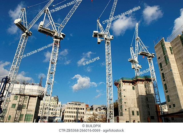 Tower cranes during the construction of 'One New Change', an office and retail development designed by Jean Nouvel at St Pauls, City of London, UK