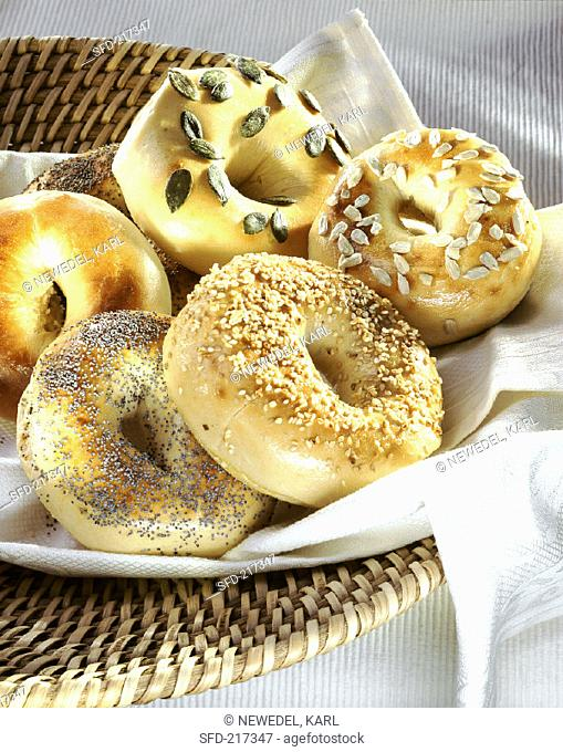 Various bagels in a bread basket