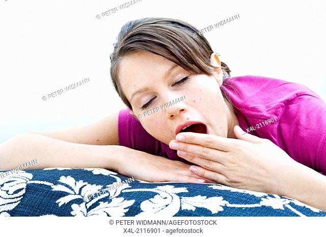 young woman yawning (model-released)