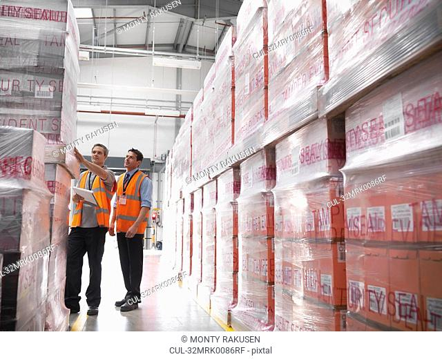 Workers in warehouse of bottling plant