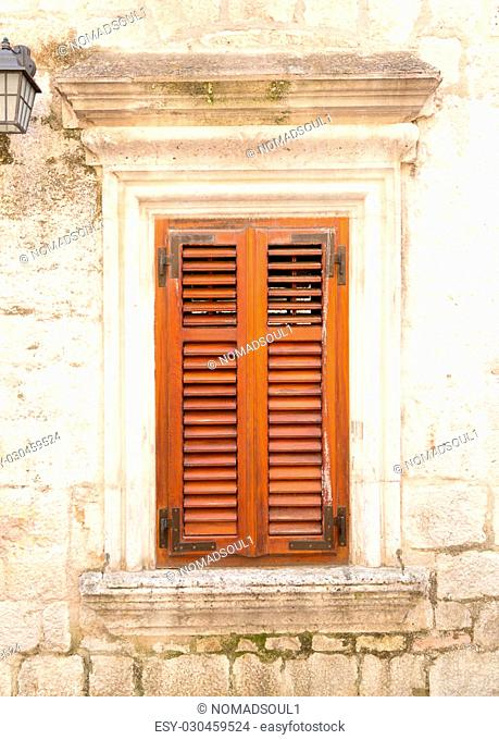 Old stone wall with wooden window