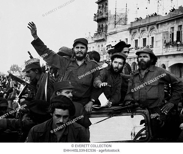 Fidel Castro, with his fellow revolutionaries, entering Havana on January 8, 1959. They are surrounded by crowds of people after their overthrow of Fulgencio...