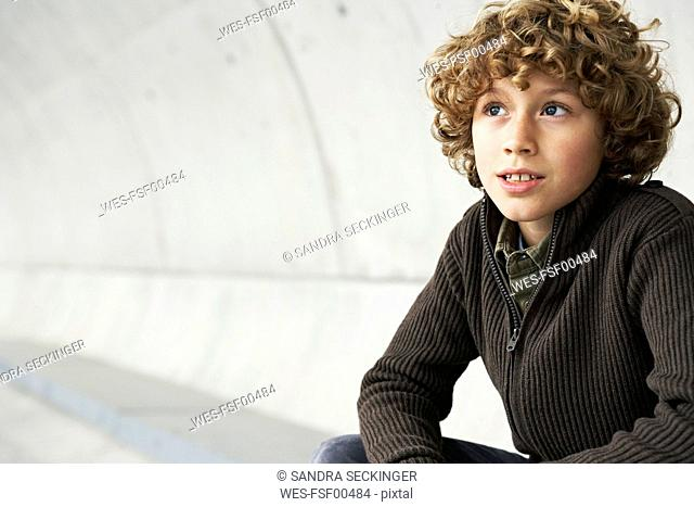 Portrait of boy with curly hair