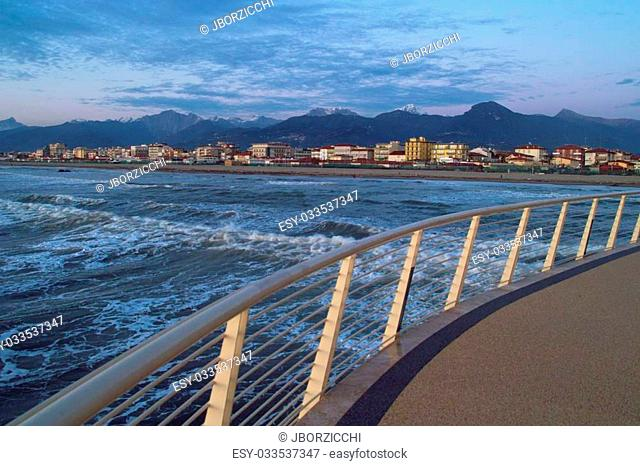 View of the coastline of versilia from a modern pier