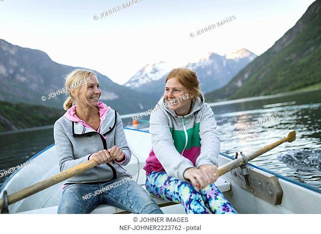 Happy women rowing