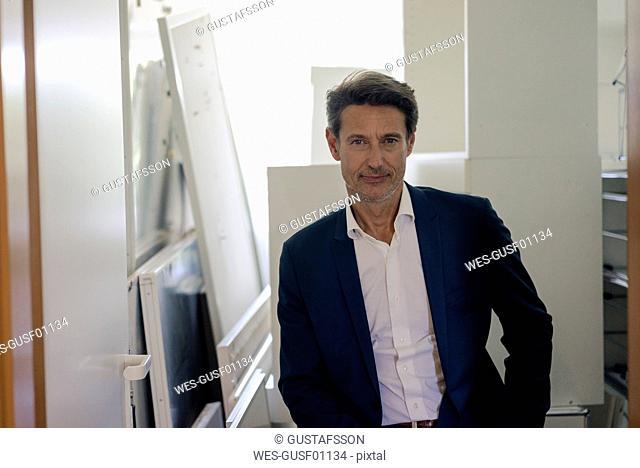 Redundant businessman sitting in storage room