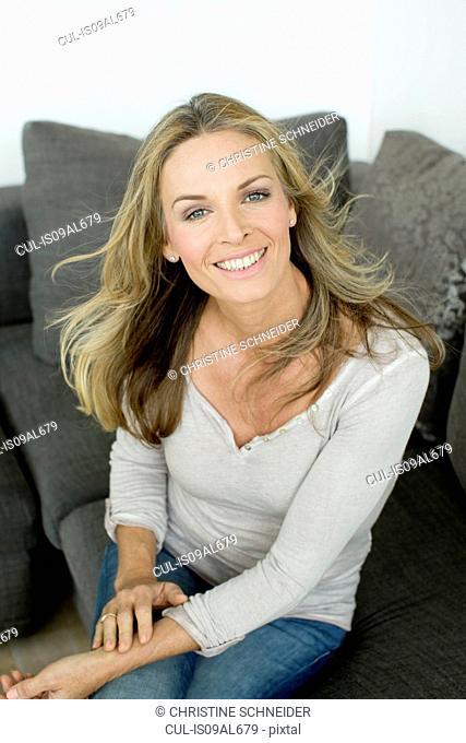 Mature blonde woman smiling, portrait
