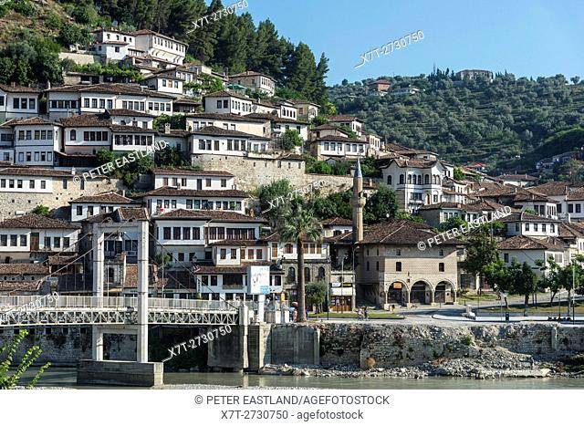 Looking across the Osumi river to the Bachelors mosque and Mangalemi district with its Ottoman period, houses in the old town of Berat in central Albania