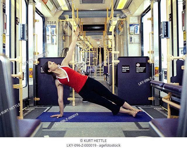 Woman doing yoga on public transportation