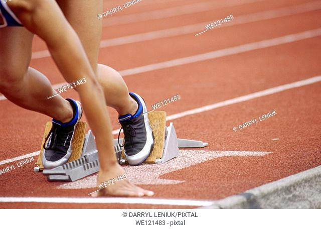 Track athlete in blocks
