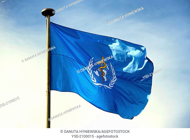 flag of W.H.O. - World Health Organization - specialized agency of the United Nations, in front of headquarters building in Geneva, Switzerland