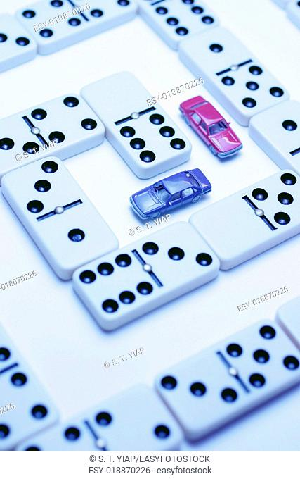 Model cars and dominoes