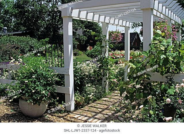Gardens: Attractive white wood arbor and fencing set in flower garden. Various angles shot