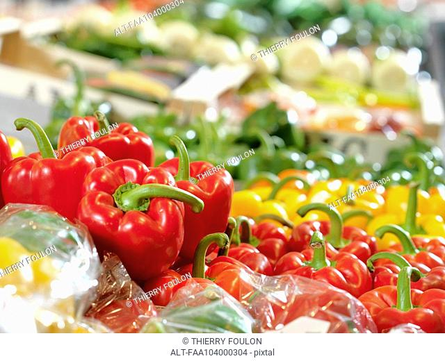 Fresh bell peppers on display at supermarket