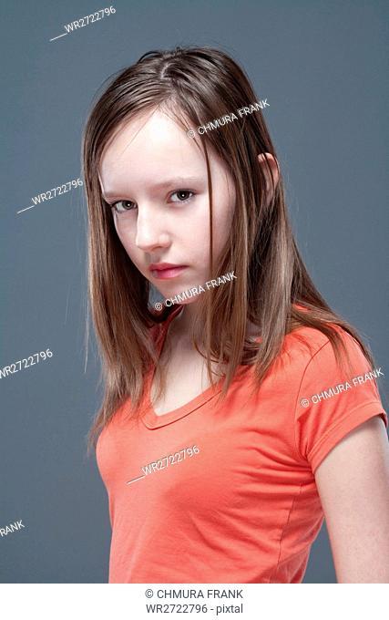 studio portrait of a pretty, eleven years old girl