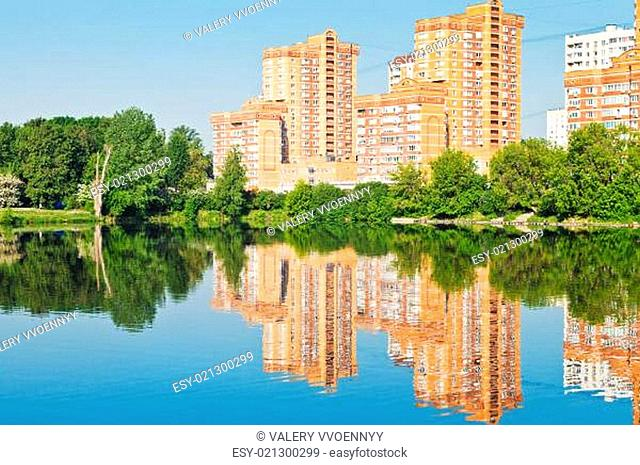 brick apartment houses on urban lakeside
