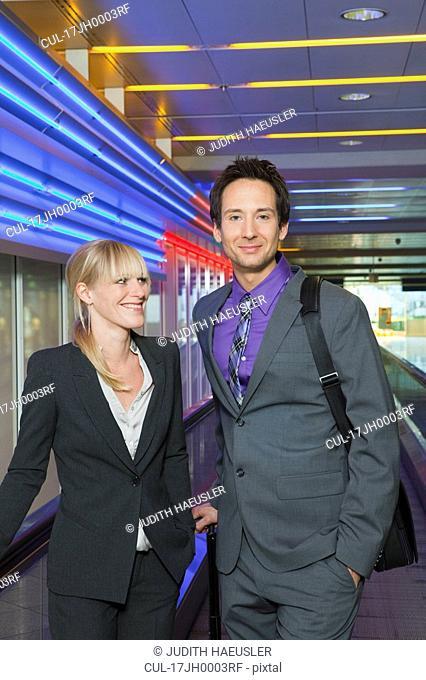 business couple on conveyor belt
