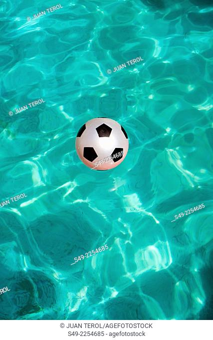 Pink ball in a swimming-pool