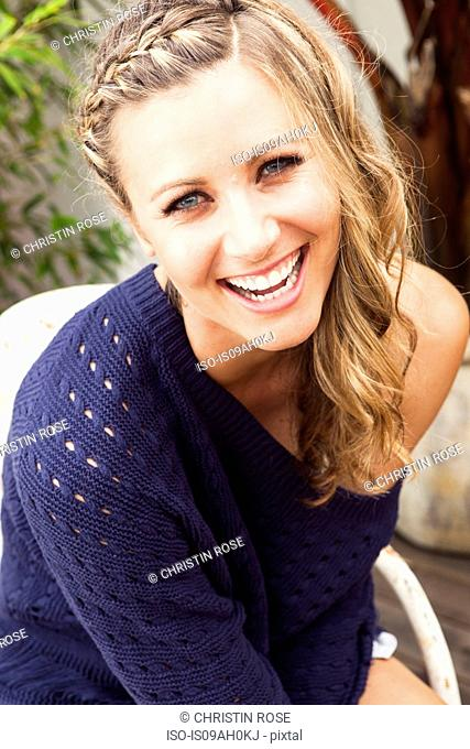 Young woman wearing purple sweater laughing