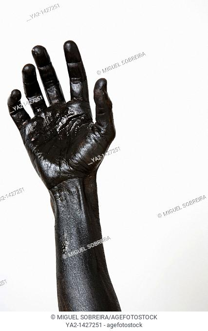 Black painted hand and arm