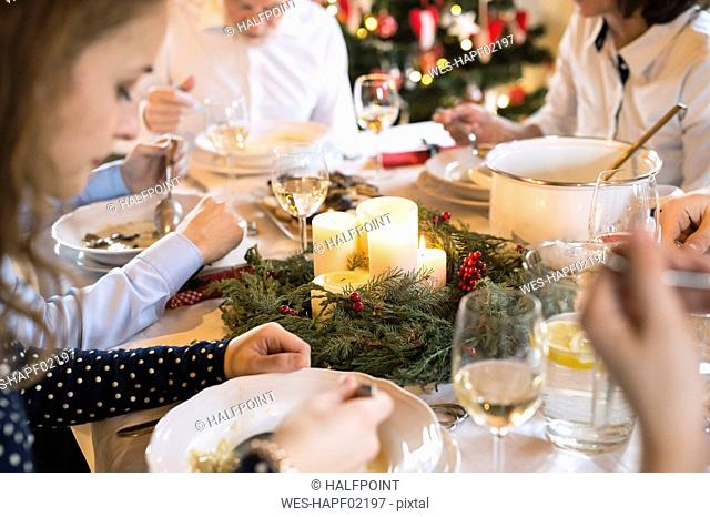 Family dining at Christmas dinner table