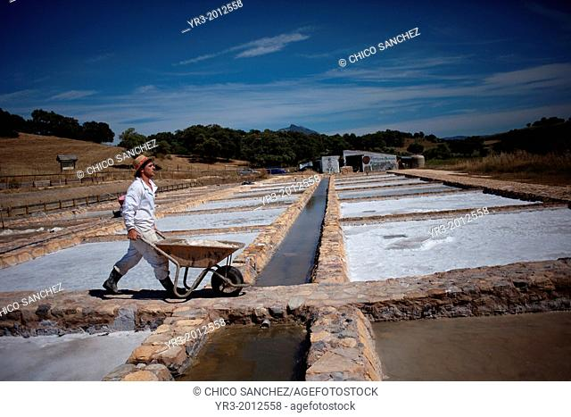 A worker carries a hand trolley at the Salinas de Hortales salt mine in Prado del Rey, Cadiz, Andalusia, Spain, July 16, 2013