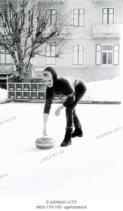 Brigitte Bardot playing curling. French actress Brigitte Bardot playing curling. Cortina d'Ampezzo, 1960s