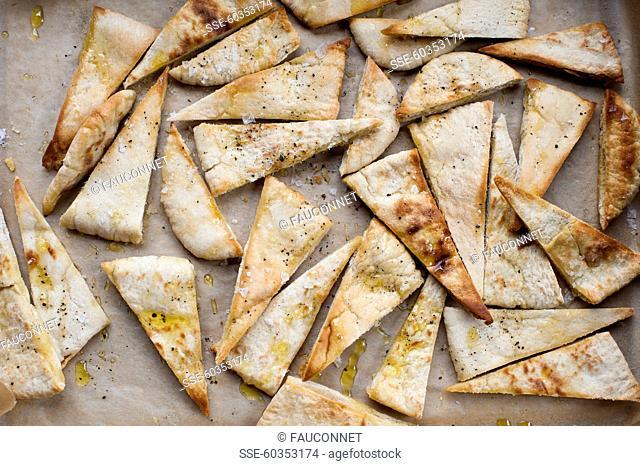 Slices of crisp pitta bread