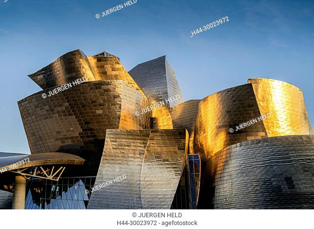 Guggenheim Museum Bilbao ,detail of titan facade at sunset, museum of modern and contemporary art , architect Frank Gehry , Bilbao, Basque Country